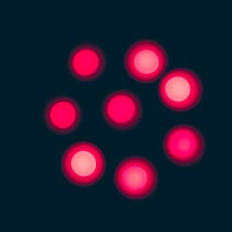Illuminated red candles on black background