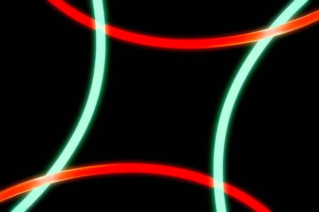 Illuminated red and green curve lights on black background
