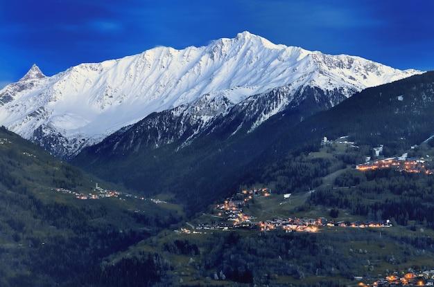 Illuminated village in mountain