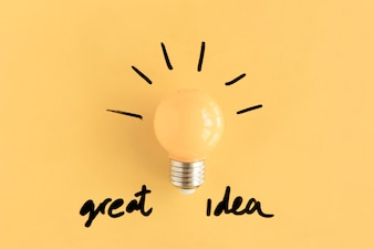 Illuminated yellow light bulb with great idea text