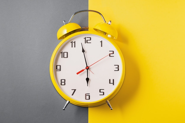 Illuminating color retro style alarm clock on ultimate gray and yellow