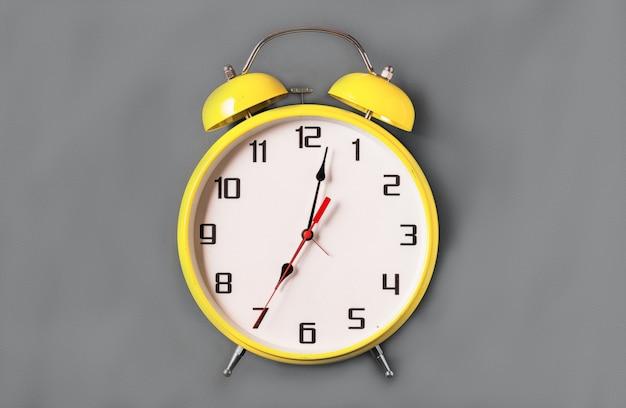 Illuminating color retro style alarm clock on ultimate gray