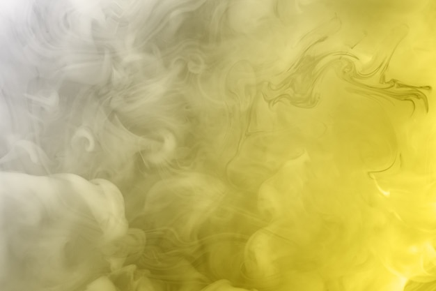 Illuminating and ultimate gray. paints dissolved in water. trending colors 2021 year. bright amazing abstract background. smoke effect.