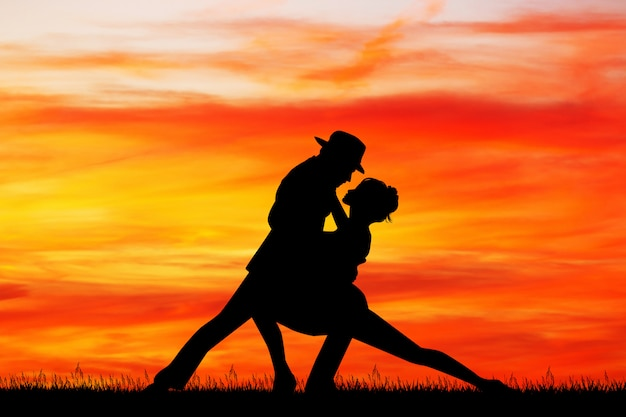 Illustration of couple dancing tango at sunset