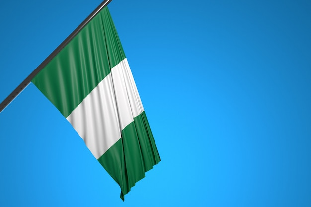 Illustration of the national flag of nigeria on a metal flagpole fluttering against the blue sky