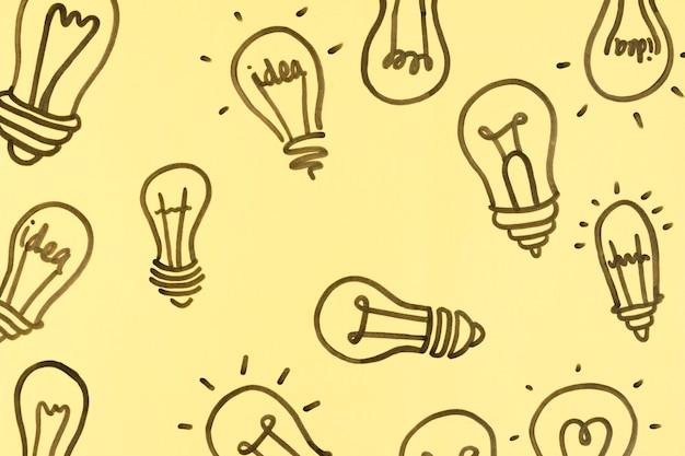 黄色の背景に多くの電球のイラスト