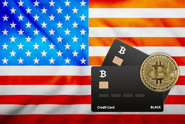 アメリカの国旗の背景に2枚の黒いクレジットカードとビットコインコインのイラスト