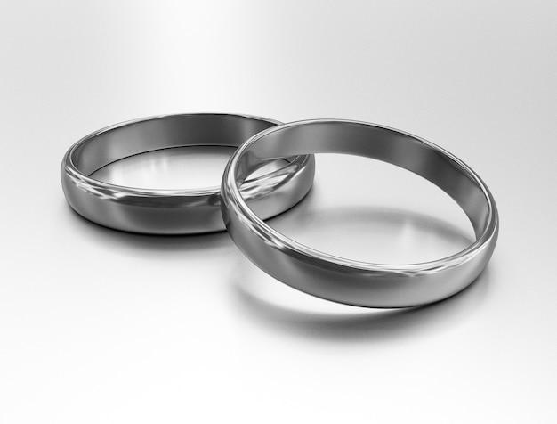 2つの結婚式の銀の指輪のイラストはお互いに横たわっています