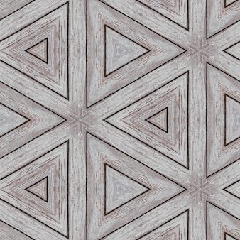 Illustrative pattern of wooden planks in the form of triangles and lines.