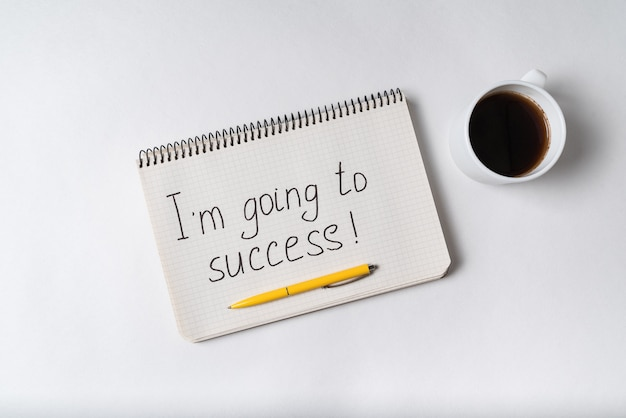 Im going to success inscription. notebook, pen and cup of coffee.