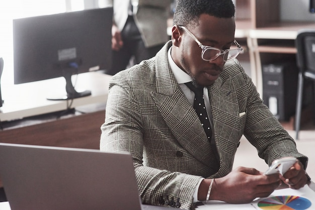 Image of african american businessman working on his laptop