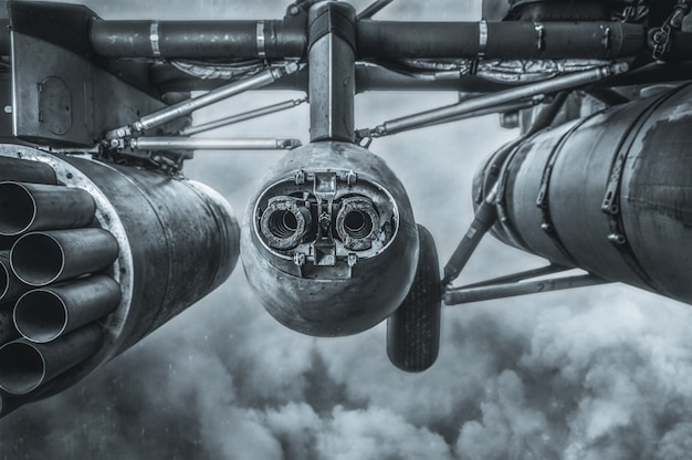 Image of the armament of a combat military helicopter. a missile launcher and a heavy machine gun. game concept. mixed media