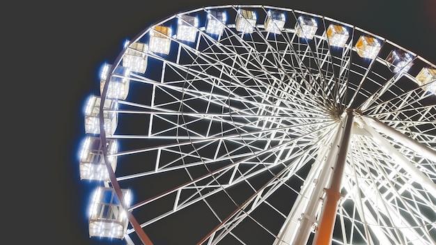 Image of beautiful big illuminated ferris wheel at night