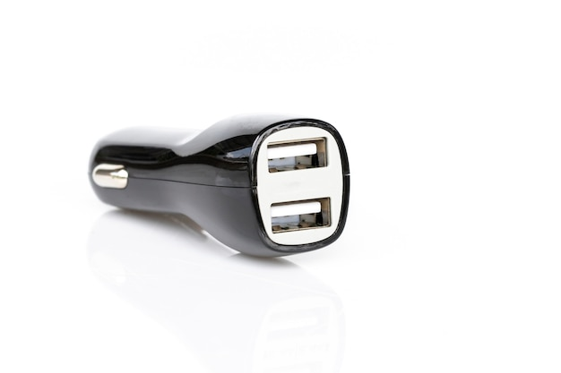 Image of black usb car charger isolated on white