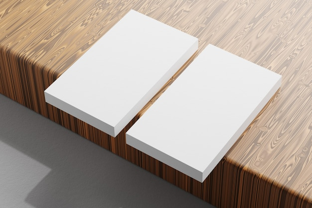 Image of blank business cards on a wooden background. template for id. top view. 3d rendering.