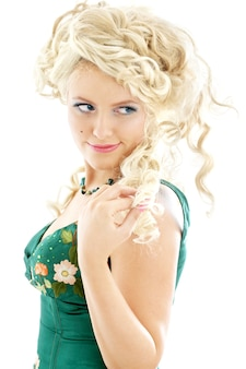 Image of blond in green dress over white