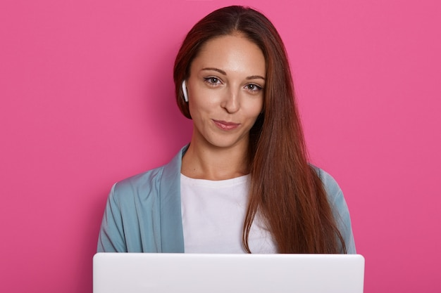 Image of businesswoman sitting in front laptop