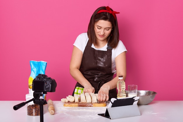 Image of busy skillful baker standing isolated over pink