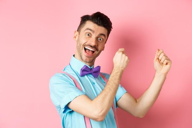 Image of cheerful man celebrating holiday
