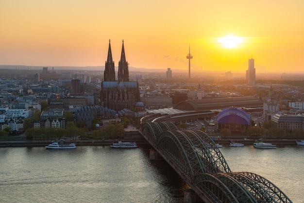 Image of cologne with cologne cathedral and rhine river during sunset in cologne, germany.