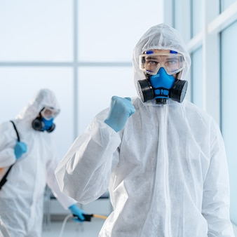 Image of a confident disinfector standing in an office lobby