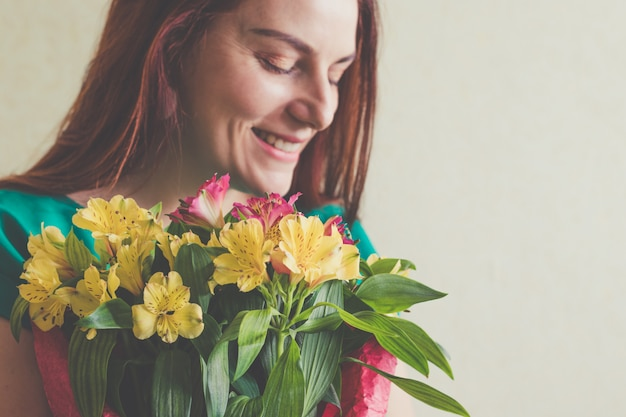 Image of cute woman with bouquet. 8 march
