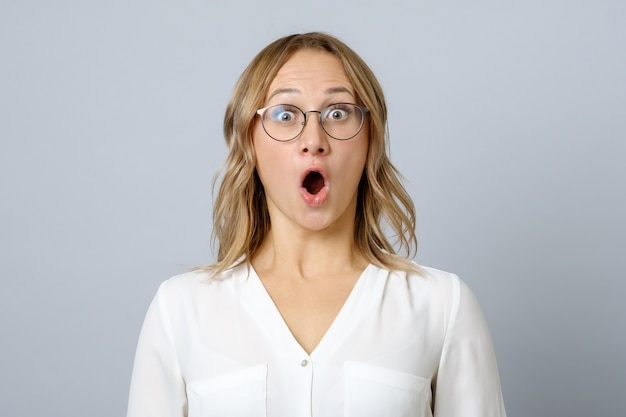 Image of excited young woman isolated