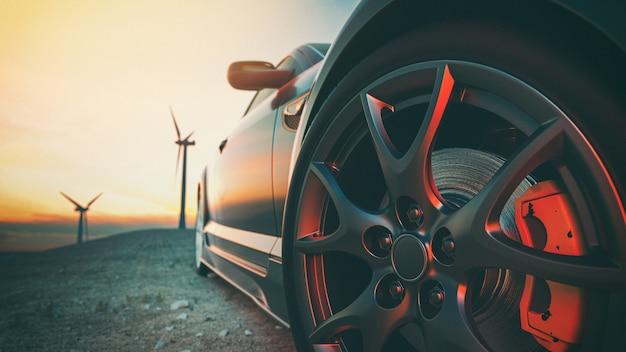 The image in front of the sports car scene behind as the sun going down with wind turbines in the back.3d render and illustration.
