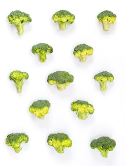 Image of a group of raw broccoli placed on a white cardboard