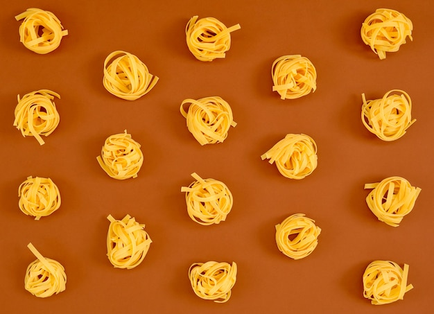 Image of a group of raw noodles placed on a brown cardboard