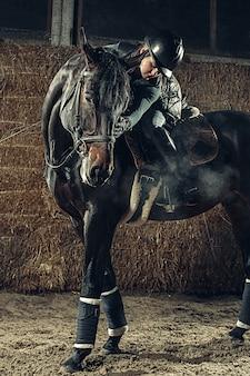 Image of happy female sitting on purebred horse