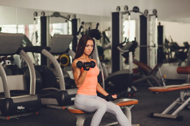 Image of healthy young female athlete doing fitness workout