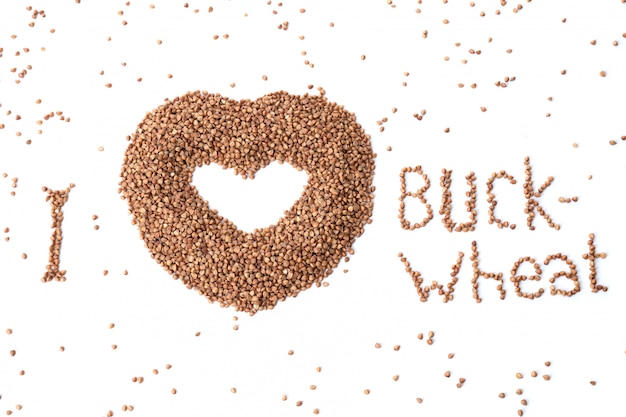 Image of a heart from buckwheat on a white background. favorite buckwheat. cereal in the form of a heart. top view of buckwheat.