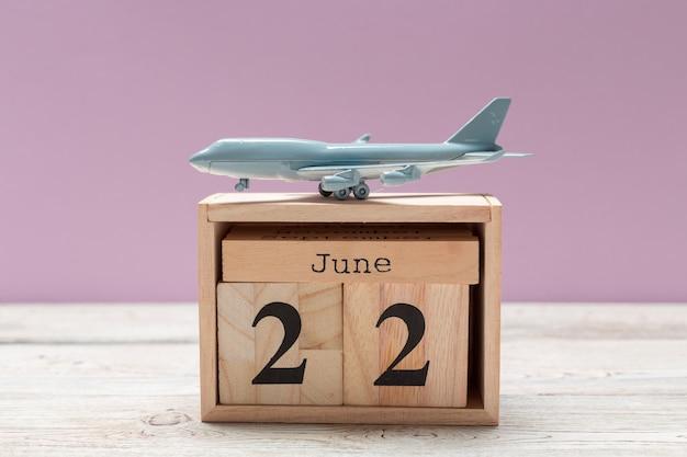 Image of june 22 wooden color calendar on wooden background
