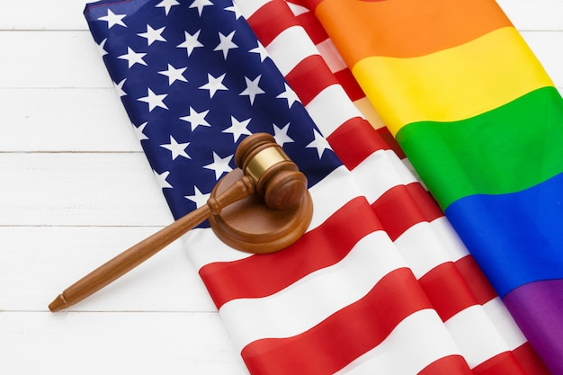 Image of a lgbt rainbow flag and american flag. gay pride