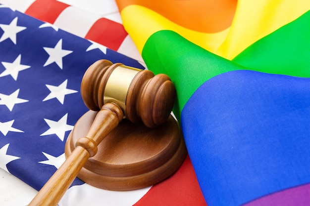 Image of a lgbt rainbow flag and american flag.