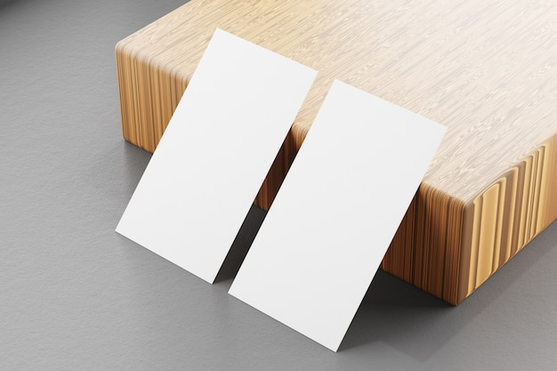An image of a mockup of business cards on a wooden background. template for identity card. 3d rendering.