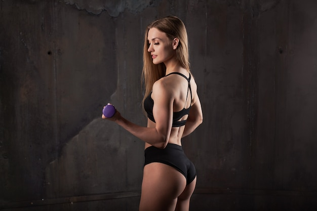 Image of muscular young female athlete