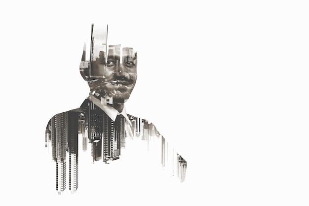 도시에 서있는 사업가의 이미지입니다. 이중 노출