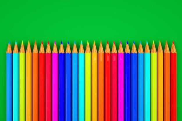 색연필의 이미지입니다. 녹색 배경에 색연필 세트입니다. 확대.