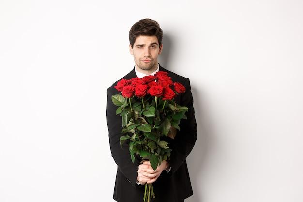 黒のスーツを着たハンサムな彼氏の画像