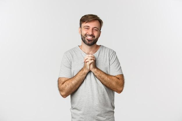 手をつないで感謝の気持ちを表すハンサムな感謝の男の画像
