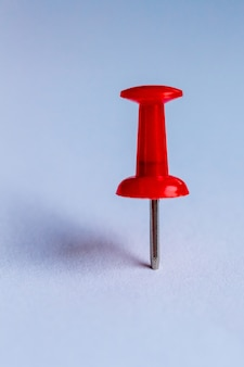 Image of the office button with a red handle on a blue background