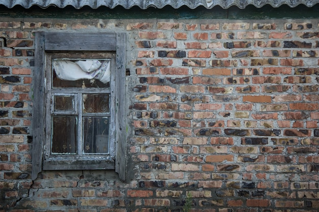 Image of old window on red brick wall