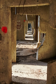 Image of perspective shot of infinite doorways in an abandoned grain elevator with an ominous feel
