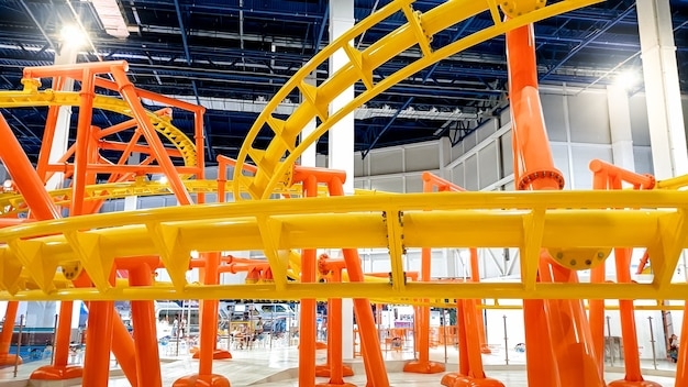 Image of roller coaster with extreme fast loops in big shopping mall