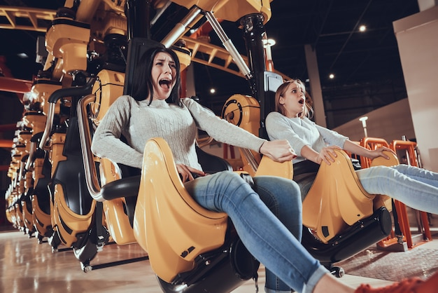 Image of shocked excited two women friends