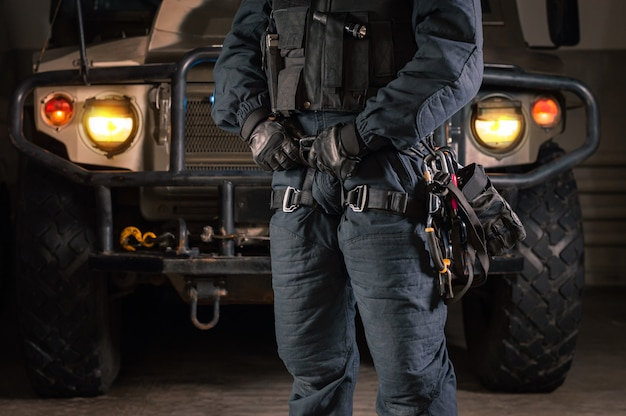 Image of a special unit soldier in front of a military truck. military security concept.