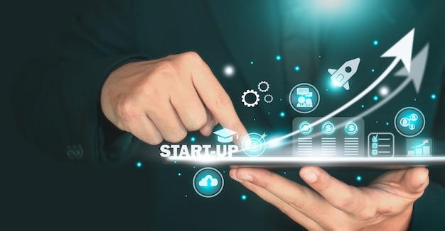 The image of start-up concept, businessan holding tablet and digital interface of business corporation. start-up concept, business concept.