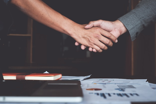 Image of successful businessmen partnership handshaking after acquisition.
